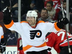 Philadelphia Flyers left wing Scott Hartnell celebrates one of his career-best 37 goals last season.