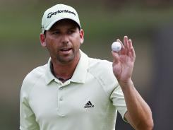 Sergio Garcia of Spain acknowledges the cheers on his way to victory in the Wyndham Championship in Greensboro, N.C.