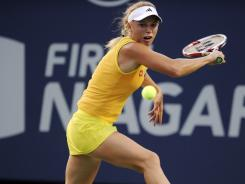 Caroline Wozniacki returns to Ekaterina Makarova during their opening round match at the New Haven Open. Wozniacki won 6-3, 6-3, claiming her 18th consecutive victory at the tournament.