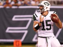 CBS analyst Boomer Esiason, a former New York Jets quarterback himself, says Tim Tebow (15) does not have enough consistency as a passer to succeed as an NFL quarterback and should not even be Mark Sanchez's backup in New York.