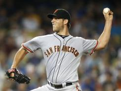 Giants starter Madison Bumgarner allowed four hits and struck out 10 in eight innings in the 2-1 win over the Dodgers.