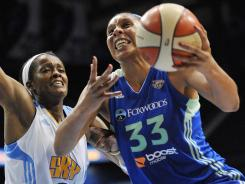 Liberty forward Plenette Pierson drives on Sky forward Swin Cash during a 77-67 New York win Tuesday.