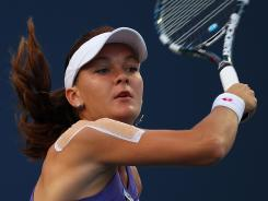 Agnieszka Radwanska returns a shot Tuesday to Olga Govortsova in her first match at the New Haven Open. She later retired with shoulder soreness.