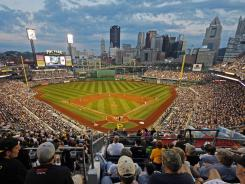 Full house: With the Pirates playing well, PNC Park  with the Pittsburgh skyline as a backdrop  is the place to be this season. The team is on pace to draw more than 2.14 million fans.