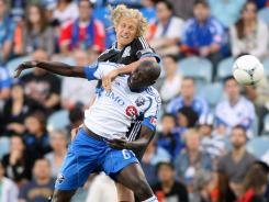Impact defender Hassoun Camara, front, was suspended for a play against Earthquakes forward Steve Lenhart in Saturday's 3-1 Montreal win.