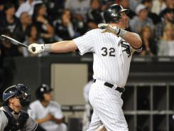 Chicago's Adam Dunn (32) hits his major-league leading 36th home run during the eighth inning, one of four White Sox players to homer in the 9-6 win.