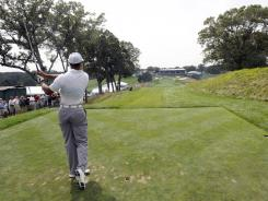Tiger Woods hits his tee shot on the 18th hole during Pro-Am for The Barclays on Wednesday at Bethpage State Park in Farmingdale, N.Y.
