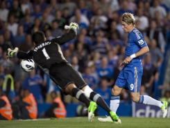 Chelsea's Fernando Torres scores past Reading goalkeeper Adam Federici, after the striker fielded a cross from Ashley Cole in what appeared to be an offside position.