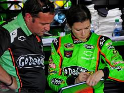 Greg Zipadelli, Danica Patrick's Sprint Cup crew chief, coaches the driver in May at Darlington Raceway.