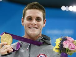 David Boudia celebrates with his gold medal in men's 10-meter platform diving final during the London Olympics on Aug.11.