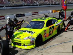 The No. 27 Chevrolet of Paul Menard gets service during Sunday's Pure Michigan 400.