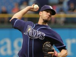 Rays' James Shields retired 12 in a row after Alcides Escobar's two-out single in the third and allowed three runs in 7 2-3 innings.