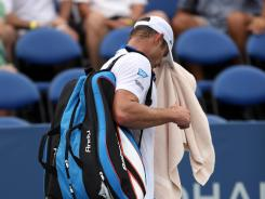 Andy Roddick of the USA heads for the exit after lost to Steve Darcis of Belgium during the third round of the Winston-Salem Open.