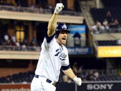 Chase Headley celebrates after hitting a two-run, walk-off home run during the 10th inning to lift the Padres to a 7-5 win over the Pirates.