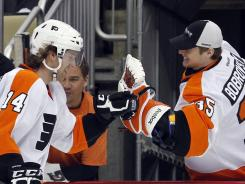 Sean Couturier, left, had a hat trick against the Penguins in Game 2 of the first round last spring.
