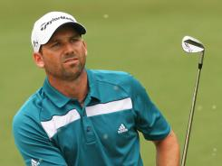Sergio Garcia of Spain, who won the Wyndham Championship on Monday, will use a caddie this week who previously worked as a spotter for CBS.