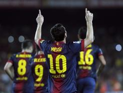 Barcelona's Lionel Messi celebrates after scoring on a penalty kick in the 70th minute.