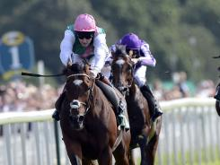 Frankel ridden by Tom Queally, foreground, wins the Juddmonte International Stakes on Wednesday in York, England.