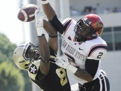 San Diego State cornerback Leon McFadden, right, breaking up a pass in a game against Army last season, is a two-time all-Mountain West first-team pick.
