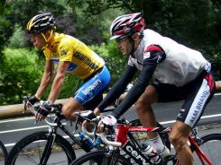 Italian Ivan Basso, right, rides next to Lance Armstrong during the 2005 Tour de France. Basso finished second in Armstrong's final Tour victory.