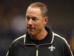 August 17, 2012; New Orleans, LA, USA; New Orleans Saints offensive line and running game coach Aaron Kromer walks off the field following a preseason game against the Jacksonville Jaguars at the Mercedes-Benz Superdome. The Jaguars defeated the Saints 27-24. Mandatory Credit: Derick E. Hingle-US PRESSWIRE ORG XMIT: USPW-82306 ORIG FILE ID: 20120817_mje_ah6_286.jpg