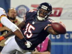 Reunited: New Bears receiver Brandon Marshall, right, will again catch passes from Jay Cutler.
