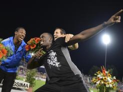 Jamaica's Yohan Blake (left), Usain Bolt and France's Renaud Lavillenie celebrate their victory at the end of Diamond League Athletics meeting &quot;Athletissima&quot; on Thursday in Lausanne.