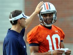 Auburn head coach Gene Chizik talks to quarterback Kiehl Frazier last season.