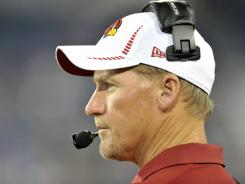 Ken Whisenhunt has the unenviable task of sorting through the Cardinals' QB mess.