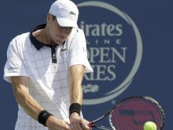 John Isner returns a shot during his semifinal match against Jo-Wilfried Tsonga in the Winston-Salem Open.