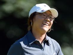 Lydia Ko, 15, reacts to a par on the fourth hole Saturday in the Canadian Women's Open.