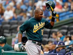 Oakland Athletics first baseman Chris Carter tips his hat to the crowd after his home run.