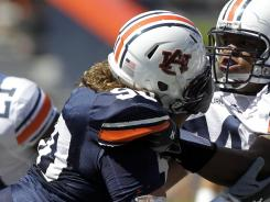 Auburn center Reese Dismukes, right, shown blocking Jamar Travis during the 2011 spring game at Jordan Hare Stadium, has been arrested for public intoxication eight days before Auburn's first game.