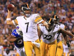 Ben Roethlisberger is chased by Bills defensive end Mario Williams during the second quarter,