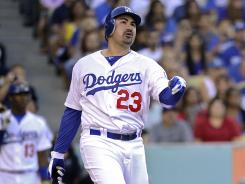 Adrian Gonzalez paid an immediate dividend, homering in his first at-bat as a Dodger.