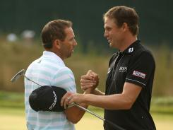 Sergio Garcia, left, and Nick Watney embrace after Garcia overtook Watney for the overall lead Saturday at The Barclays.