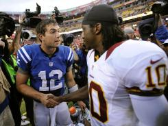 Andrew Luck, left, greets Robert Griffin III after the game.