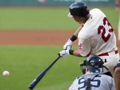 The Indians' Michael Brantley tees off on a three-run homer in the first inning.