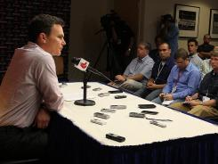 """Red Sox GM Ben Cherington formally announces the trade at a press conference Saturday. """"The one thing you know about the Red Sox is they have some kind of plan in place,"""" Yankees pitcher Derek Lowe said."""