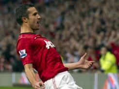 Robin van Persie celebrates after scoring his first goal for Manchester United.