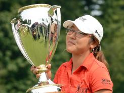 Amateur Lydia Ko of New Zealand hoists the trophy after winning the CN Canadian Women's Open on Sunday.