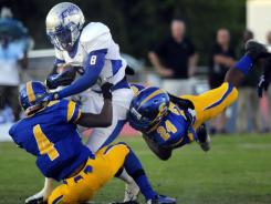 Akia Booker (8) of No. 5 Byrnes (Duncan, S.C.) ran for three touchdowns and caught two touchdown passes in a 42-21 defeat of No. 17 Oscar Smith (Chesapeake, Va.).