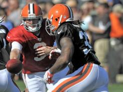 The Browns are banking on QB Brandon Weeden, center, and RB Trent Richardson now and into the future.