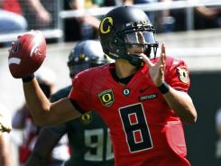 """All I have to do is distribute the ball,"" says Oregon QB Marcus Mariota, shown here on April 28 during the Ducks' spring game."