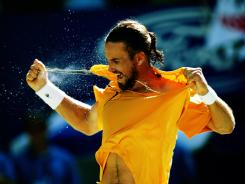 Photographer Clive Brunskill was well-positioned to capture this shot of Patrick Rafter ripping his shirt after a fourth-round victory during the 2001 Australian Open in Melbourne.