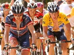 If Lance Armstrong, right in yellow jersey, had cooperated in the U.S. Anti-Doping Agency's investigation of doping in cycling, he might have been protected by an eight-year statute of limitations that would have caused him to lose only two of his seven Tour de France titles, 2004 (pictured here) and 2005, USADA chief Travis Tygart tells USA TODAY Sports.