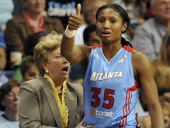 Marynell Meadors, left, with Atlanta star Angel McCoughtry, led the Dream to back-to-back appearances in the WNBA Finals in 2010 and 2011.