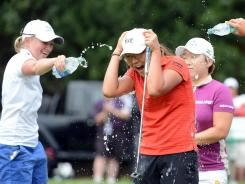 Lydia Ko of New Zealand is doused with water by Stacy Lewis and Jiyai Shin in celebration of her victory Sunday in the CN Canadian Women's Open.