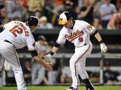 Nate McLouth is greeted by Mark Reynolds after his go-ahead two-run homer in the eighth inning.