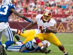Redskins running back Alfred Morris makes a move on Colts cornerback D.J. Johnson on his way to 107 yards and a touchdown in Saturday's preseason clash.